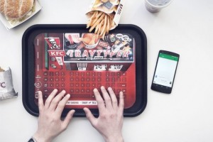 The German franchise of the global fast food group KFC has launched a new food tray in its German restaurants which includes a keyboard.